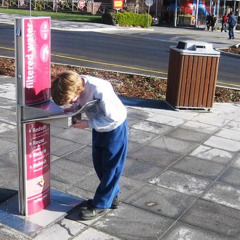 kid drinking at fountain